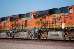 BNSF 6627 rolls eastbound with BNSF 7548 in front and BNSF 6620 behind her.